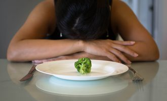 Woman Distressed With Tiny Piece Of Food In Front Of Her